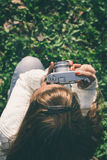 Girl with old camera Royalty Free Stock Photography