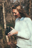 Girl with old camera Stock Image