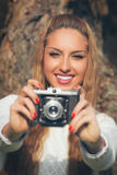 Girl with old camera Royalty Free Stock Image
