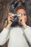 Girl with old camera Stock Images