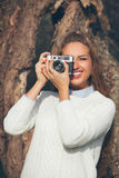 Girl with old camera Royalty Free Stock Photo