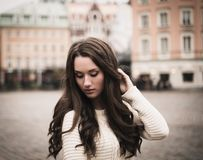 Girl in old european town Stock Images
