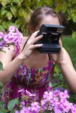 Girl with old-fashioned camera Royalty Free Stock Images