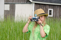 Girl with old-fashioned camera Royalty Free Stock Image