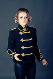 Girl in the old-fashioned uniform Stock Photos