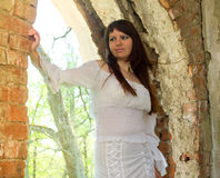 Girl in old-fashioned white dress among ruins of old manor 20 Royalty Free Stock Image