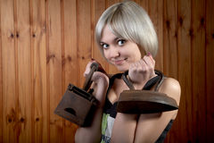 The girl with old irons Stock Images