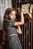 Girl in the old library Royalty Free Stock Photo