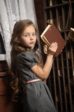 Girl in the old library Stock Photo