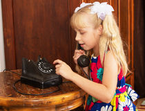 The girl with the old phone Royalty Free Stock Photography