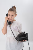 Girl with old phone Royalty Free Stock Photography