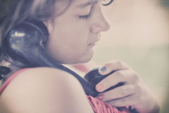 Girl with old phone. Royalty Free Stock Photo
