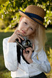 Girl with old photocamera Stock Photography