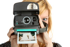 Girl with old point and shoot instant camera Stock Images