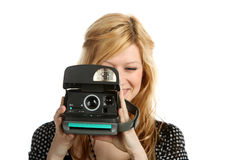 Girl with old point and shoot instant camera Royalty Free Stock Image