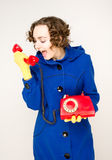 Girl with old red telephone. Screaming Royalty Free Stock Photos