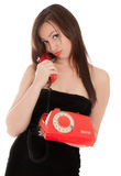 Girl with old red telephone talking Stock Photos