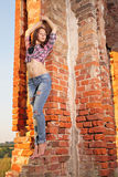 Girl on old ruins Stock Images