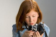 Girl with old SLR photo camera. Girl holding old SLR photo camera Royalty Free Stock Photography
