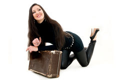 Girl with an old suitcase. A beautiful girl with an old tattered suitcase Stock Photo