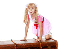 Girl with old suitcase Royalty Free Stock Images