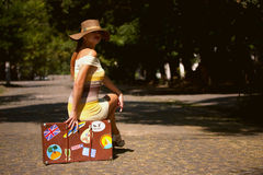 Girl with old suitcase Stock Photography