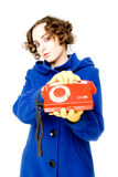 Girl with old telephone (focus on the telephone) Royalty Free Stock Images