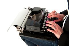 Girl with old typewriter Royalty Free Stock Image