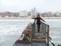 Girl on old wharf. End of winter season in Rimini, Italy - beach without people Royalty Free Stock Photography