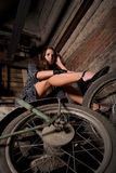 Girl with old wheel Stock Photography