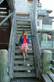 Girl and old wooden stairs. Girl coming down old stairs stock images