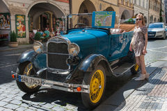 Girl and Oldtimer in Prague Streets Royalty Free Stock Image