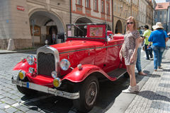 Girl and Oldtimer in Prague Streets Stock Images