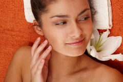 Girl with olive skin at spa Royalty Free Stock Image