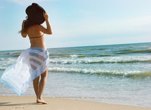 Girl On A Beach Stands By A Back Royalty Free Stock Photography