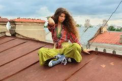 Girl On A Roof Stock Image
