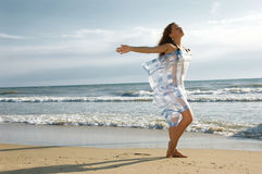 Girl On A Sea Beach Stands And Waves Hand Stock Images