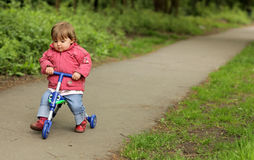 Girl On A Tricycle Stock Images