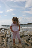 Girl On Cloudy Coast Stock Images