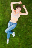 Girl On Green Grass Stock Photo