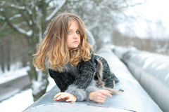 Girl On Heating Main Stock Images