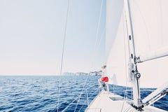 Girl On Sailboat Stock Photo