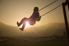Girl On Swing At Sunset Stock Images