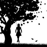 Girl On Swing Silhouette Stock Photo
