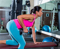 Girl one arm dumbbell bent over row workout Royalty Free Stock Photos