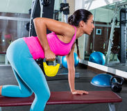 Girl one arm kettlebell bent over row workout Royalty Free Stock Photos