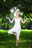 A girl in one of the yoga postures Stock Photo