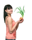 Girl and an onions.  It is isolated. The image of the girl holding onions Royalty Free Stock Photography