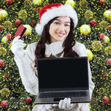 Girl online shopping to prepare christmas Stock Photo