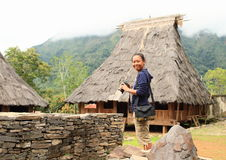 Girl in open-air museum in Wologai Stock Photos